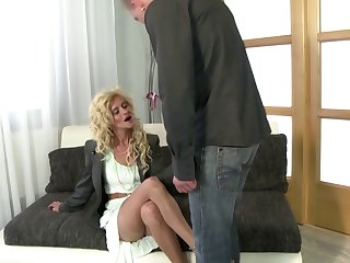 Blonde mature mom in stockings sucks her boy dick