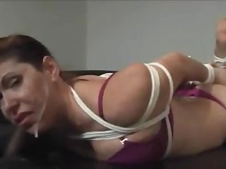 Tied up and ball gagged slut forced to suck gets facial