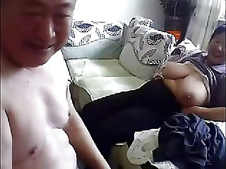 Mature Chinese pair fucks at home