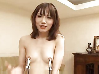 Whore with clamped tits sucking