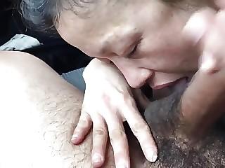 Korean 45 yo sucking a cock