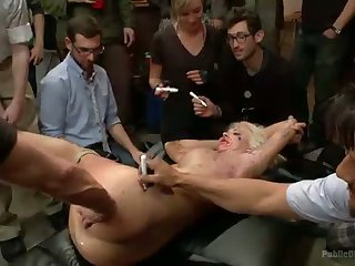 Big titted blonde drilled in a crowded gallery