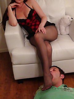 12 of Megan smothers stockings feet all over face of her slave