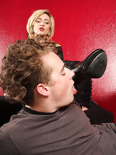 <!–-IMAGE_COUNT-–> of Manchester makes slave boy lick on her boots