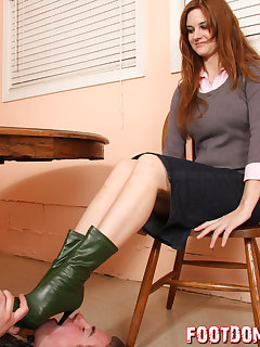 12 of Licking Jennifer's boots under her table