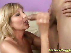 Amateur busty mature milf jerking a hard dick